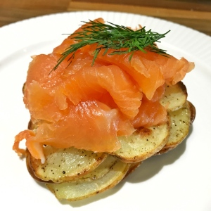 Smoked salmon on sliced potato