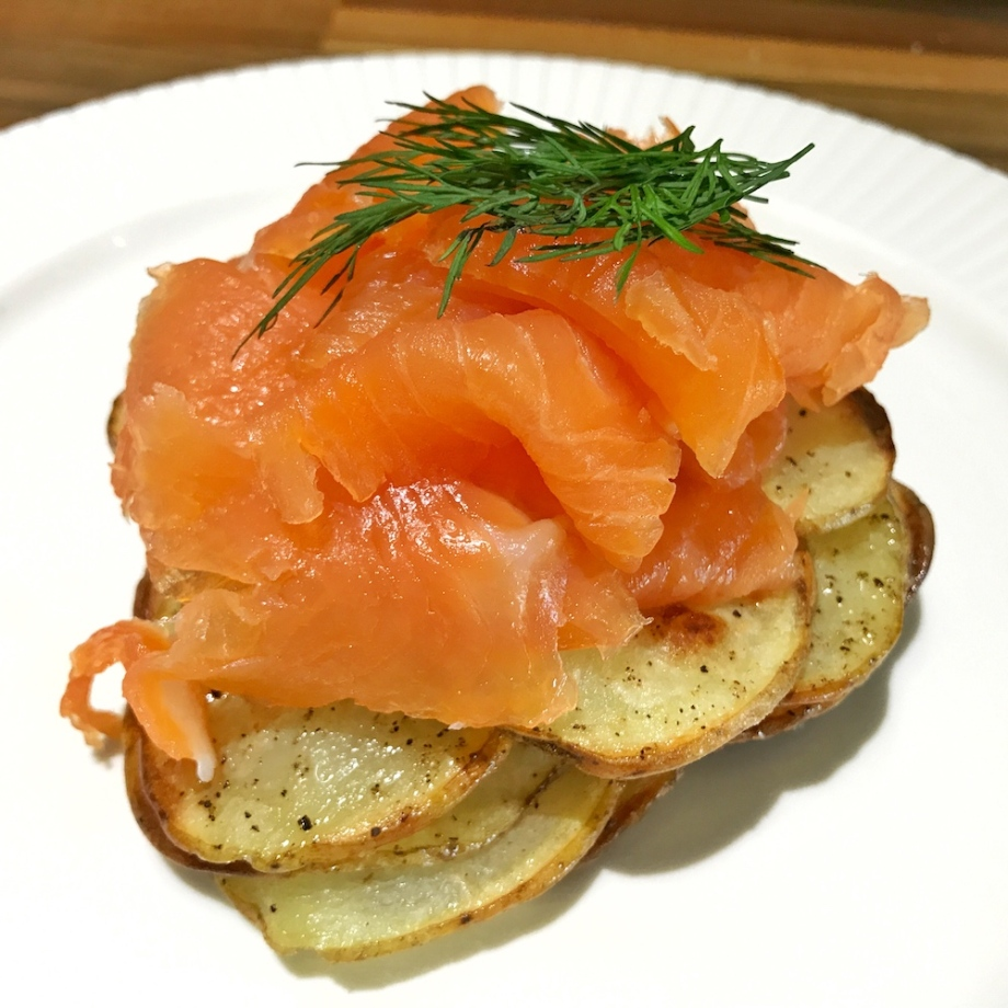 Smoked salmon on sliced potato