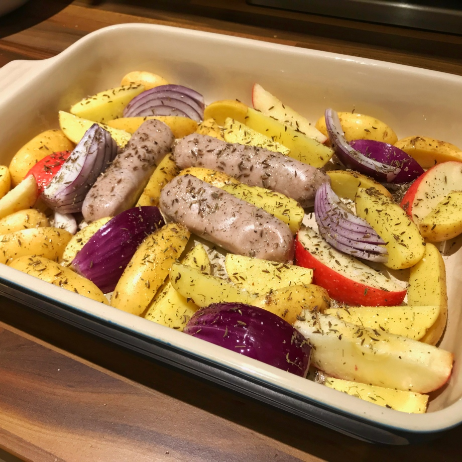 Sausage, apple and red onion tray bake with Vivaldi potatoes